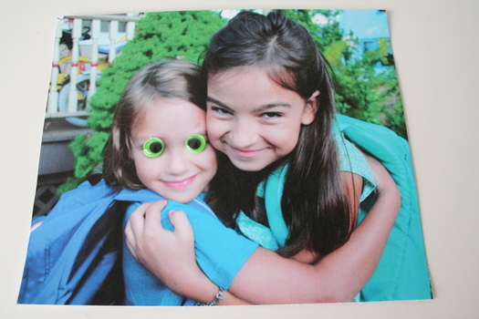 photos of kids with green googly eyes glued to it