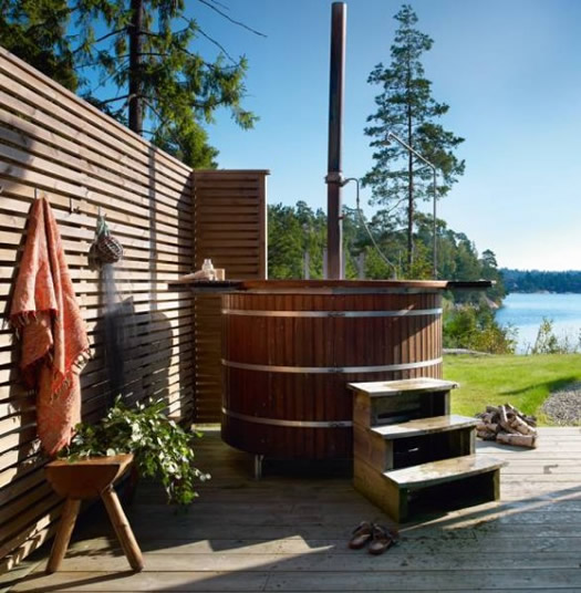 Hot tub and outdoor deck of Swedish cabin