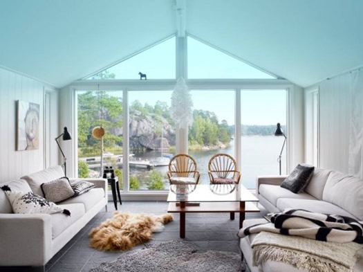 living room of Swedish cabin via Nordic Design