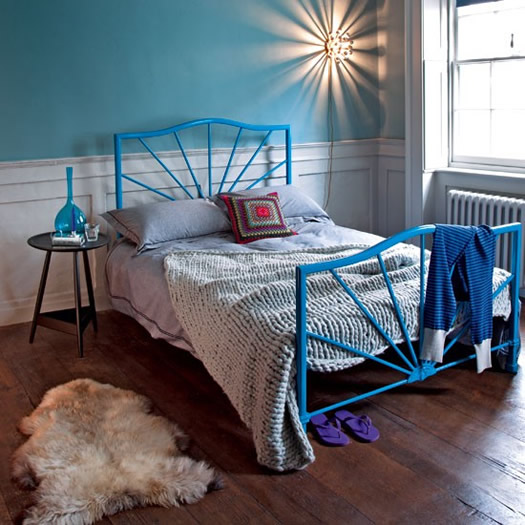 Blue bedroom and bed via Living Etc