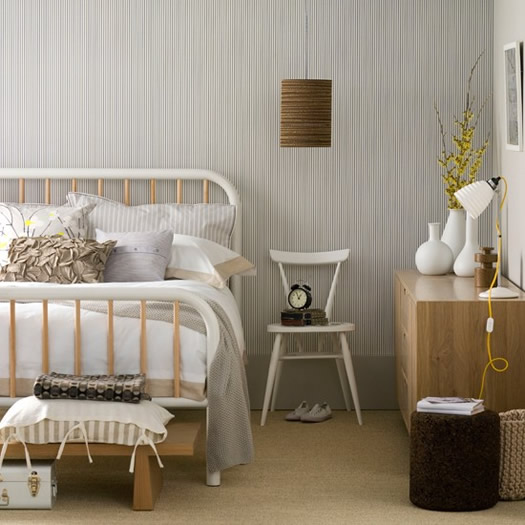 Neutral bedroom with monochrome wallpaper via Living Etc