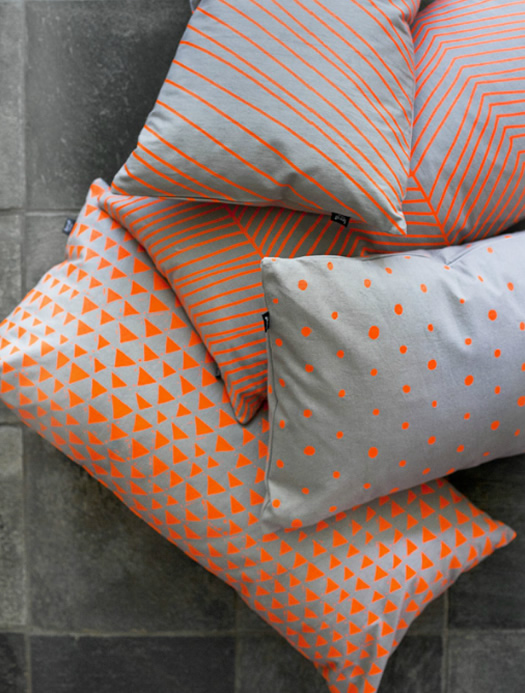 Neon orange pillows by Ferm Living
